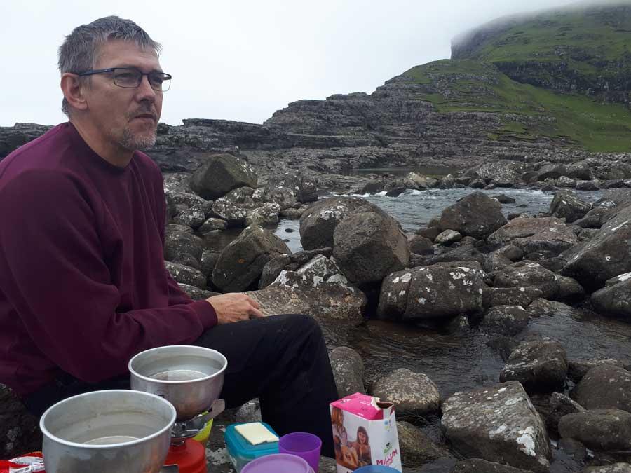 Man at Bøssdalafossur in Vágar, Faroe Islands
